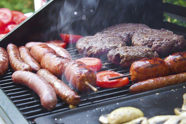 meat cooking on barbecue grill